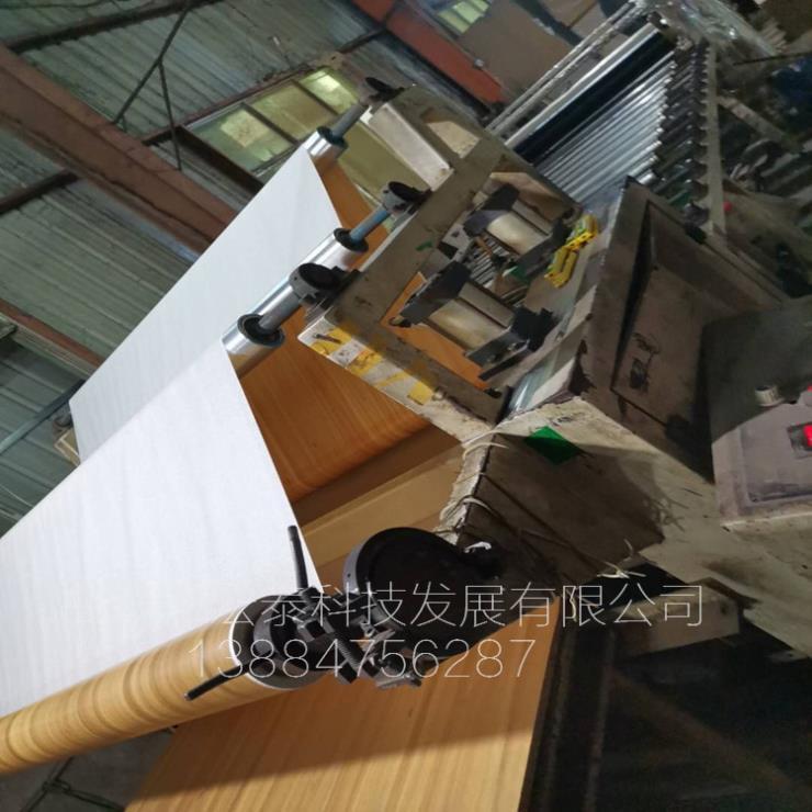 高碑店钢板贴面机