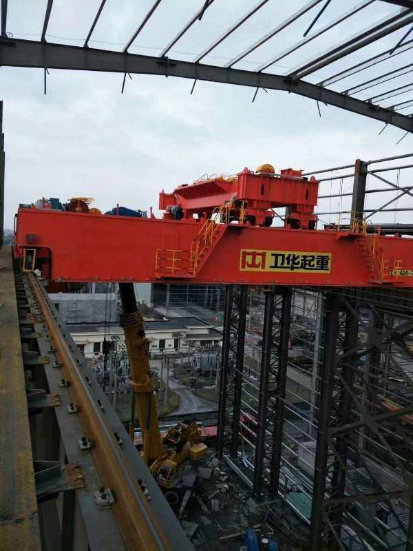 河南卫华新闻:900吨MDG型100/5吨门式起重机