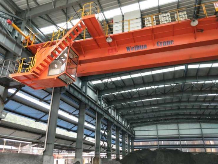 卫华股份新闻:74吨8吨XG电动悬挂过轨起重机拆迁